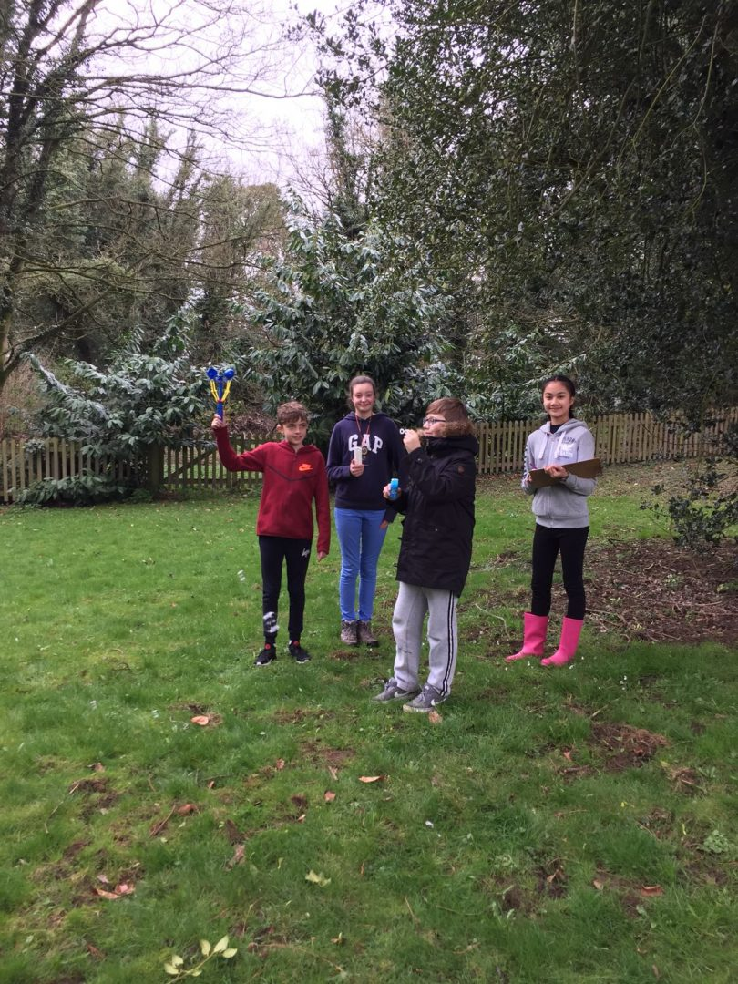 QHS performing bubbles experiment in the garden