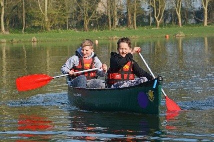 QHS students paddle canoe at PGL