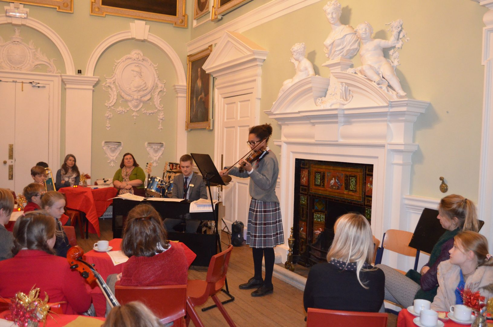 Tea Time Concert at QHS - pupil playing the violin
