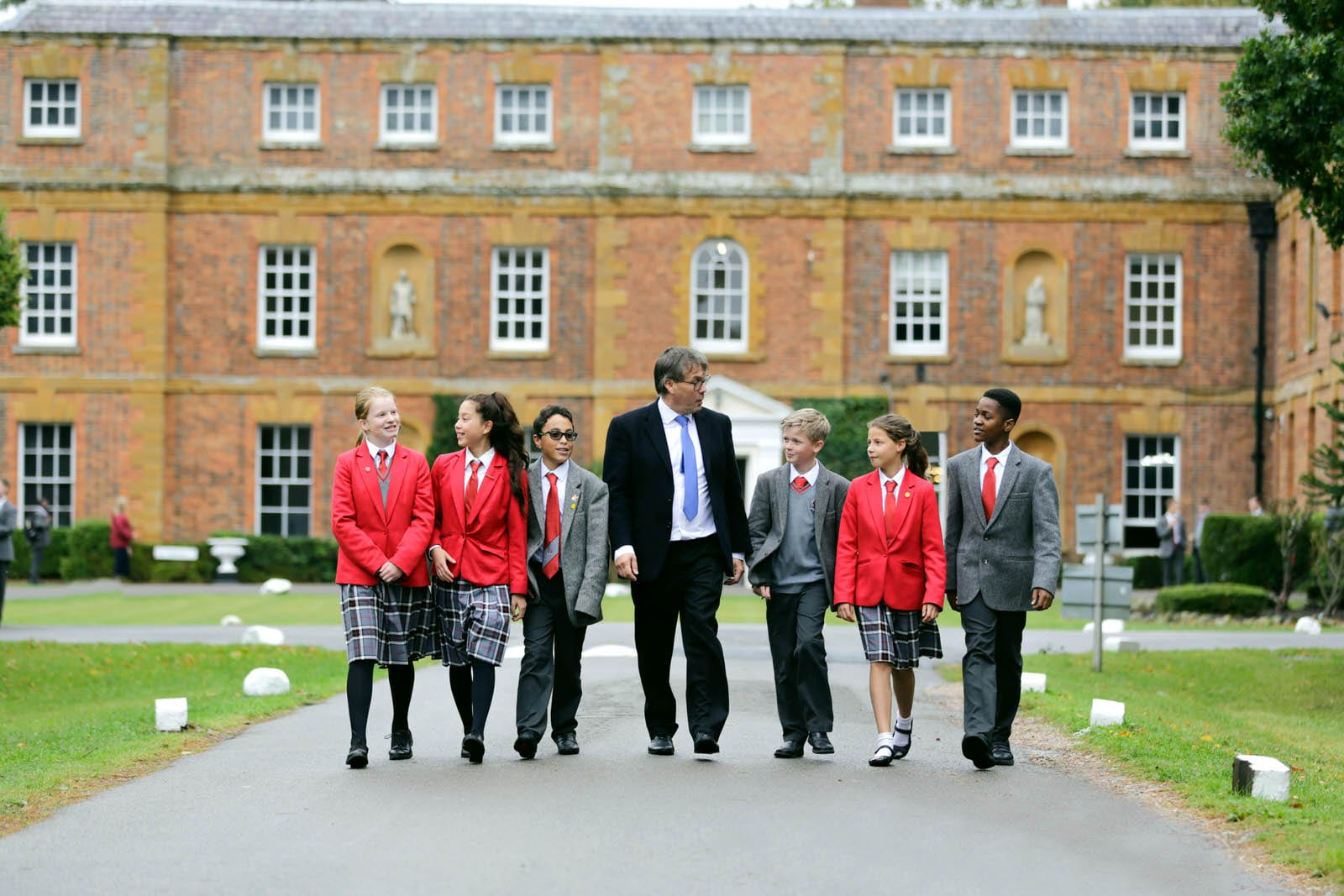 Headmaster walking with pupils