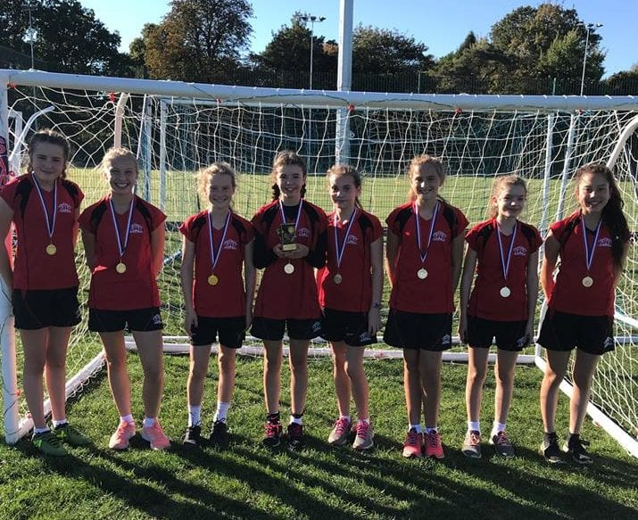 Quinton girls celebrate with football medals